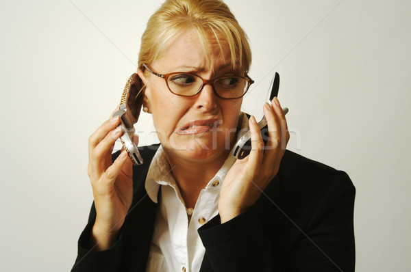Frustrated Cell Phone Businesswoman. Stock photo © feverpitch