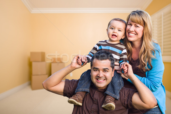 Young Mixed Race Family In Room With Moving Boxes Stock photo © feverpitch
