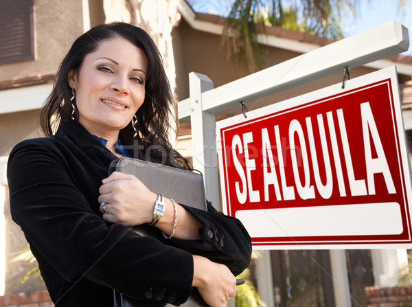 Female Hispanic Real Estate Agent, Se Alquila Sign and House Stock photo © feverpitch