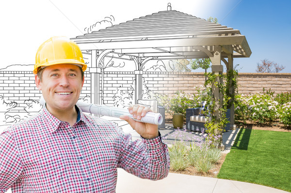 Contractor In Front of Drawing Gradating Into Photo of Finished  Stock photo © feverpitch
