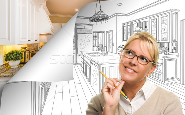 Woman Facing Kitchen Drawing Page Corner Flipping with Photo Beh Stock photo © feverpitch