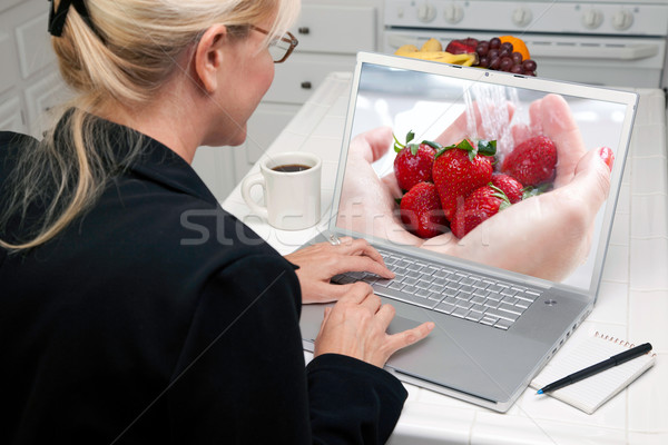 Woman In Kitchen Using Laptop - Food and Recipes Stock photo © feverpitch