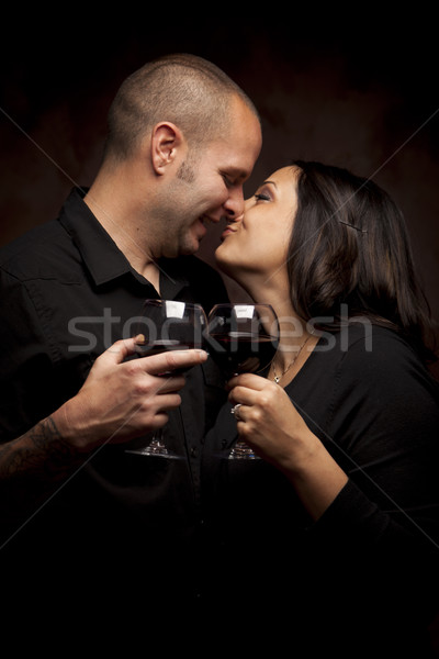 Happy Mixed Race Couple Holding Wine Glasses Stock photo © feverpitch