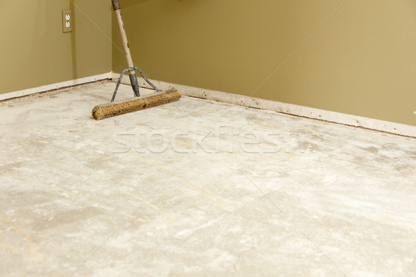 Concrete House Floor with Broom Ready for Flooring Installation Stock photo © feverpitch