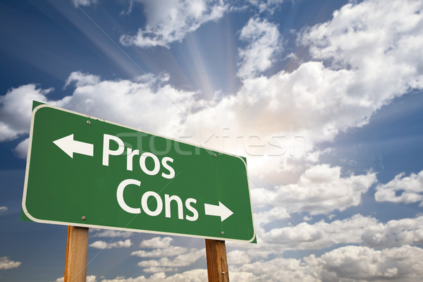 Pros and Cons Green Road Sign Over Clouds Stock photo © feverpitch