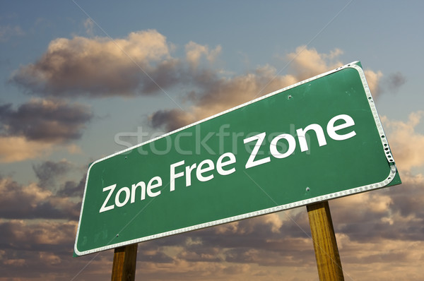 Zone Free Zone Green Road Sign and Clouds Stock photo © feverpitch