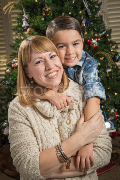 Mother and Mixed Race Son Hug Near Christmas Tree Stock photo © feverpitch