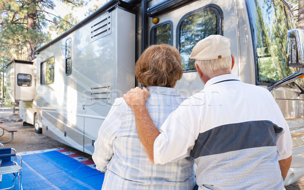 Senior Couple Looking At A Beautiful RV At The Campground. Stock photo © feverpitch