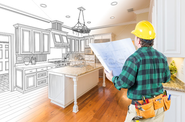 Male Contractor with Hard Hat and Plans Looking At Custom Kitche Stock photo © feverpitch
