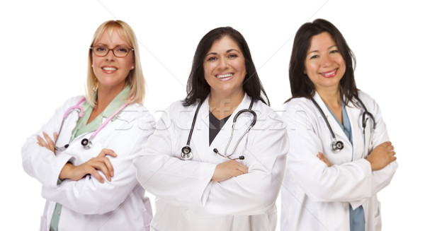 Three Female Doctors or Nurses on White Stock photo © feverpitch