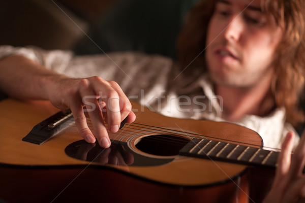 Young Musician Plays His Acoustic Guitar Stock photo © feverpitch