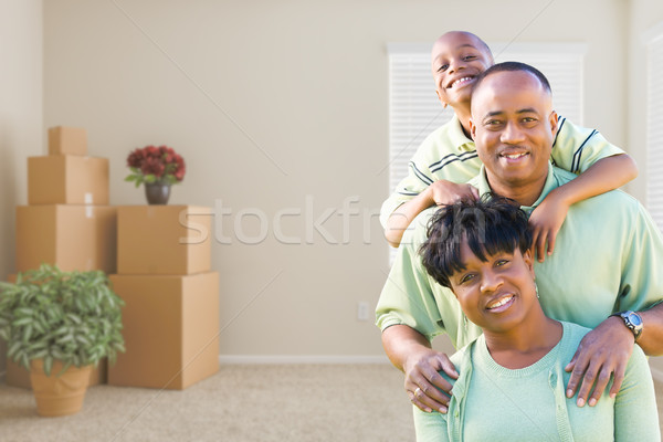 African American Family In Room with Packed Moving Boxes Stock photo © feverpitch