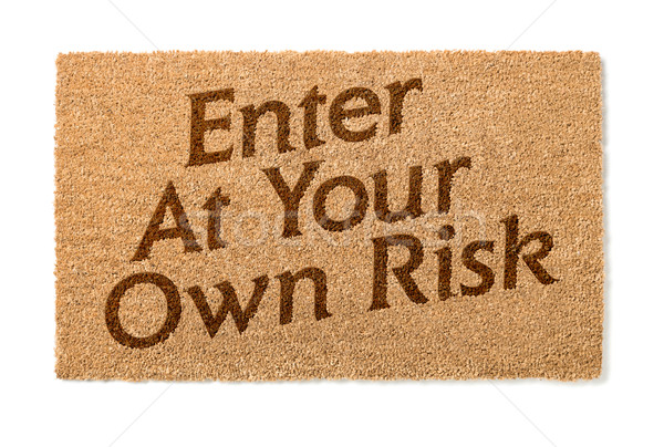 Enter At Your Own Risk Welcome Mat On White Stock photo © feverpitch
