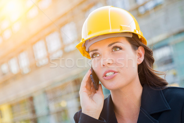 Young Professional Female Contractor Wearing Hard Hat at Contruc Stock photo © feverpitch