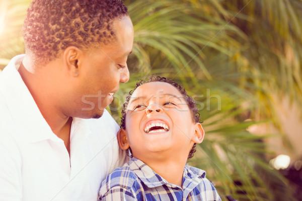 Filho africano americano pai jogar ao ar livre Foto stock © feverpitch