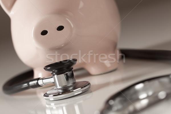 Piggy bank estetoscópio foco negócio saúde medicina Foto stock © feverpitch