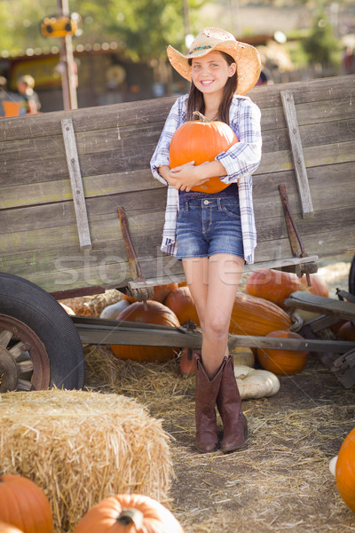 Pretty Preteen Girl Portrait at the Pumpkin Patch Stock photo © feverpitch