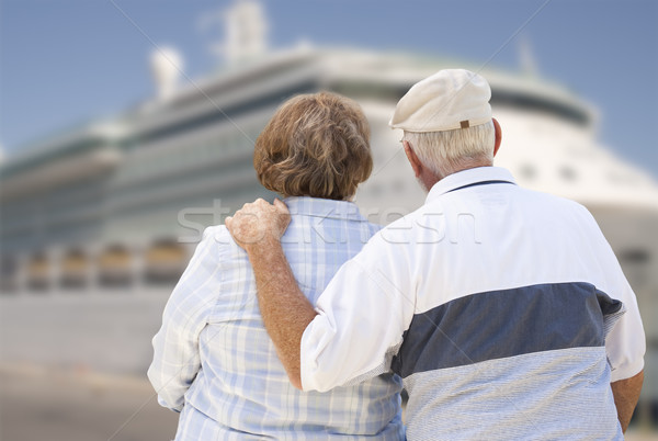 Senior Couple On Shore Looking at Cruise Ship Stock photo © feverpitch