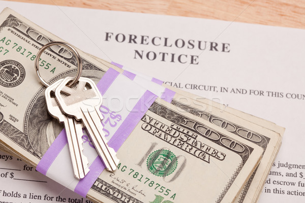 House Keys, Stack of Money and Foreclosure Notice Stock photo © feverpitch