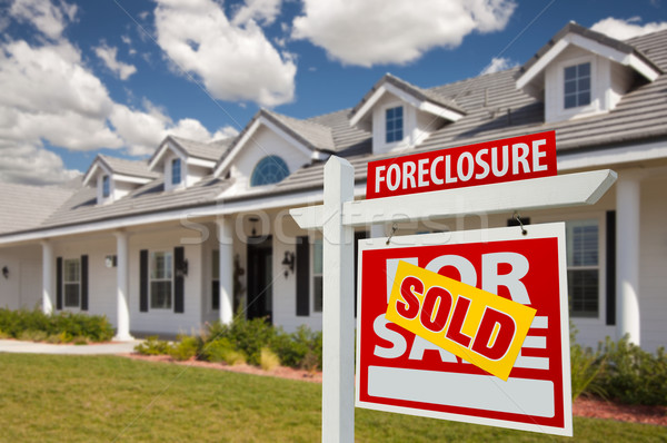 Stock photo: Sold Foreclosure Real Estate Sign and House - Right