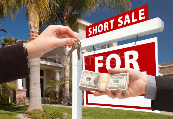 Handing Over Cash For House Keys and Short Sale Sign Stock photo © feverpitch
