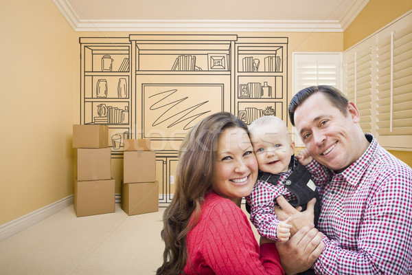 Young Family In Room With Drawing of Entertainment Unit On Wall Stock photo © feverpitch