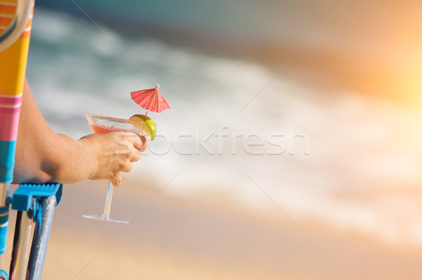 Woman on Beach with Tropical Drink Stock photo © feverpitch