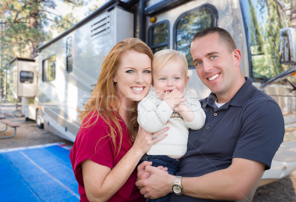 Happy Young Military Family In Front of Their Beautiful RV At Th Stock photo © feverpitch