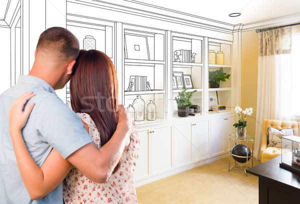 Young Military Couple Facing Custom Built-in Shelves and Cabinet Stock photo © feverpitch