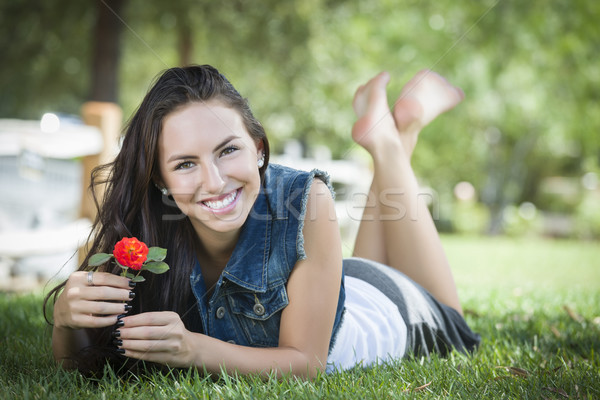 Attractive Mixed Race Girl Portrait Laying in Grass Stock photo © feverpitch