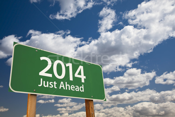 2014 Just Ahead Green Road Sign Over Clouds and Sky Stock photo © feverpitch