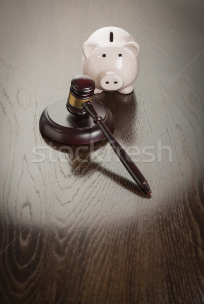 Gavel and Piggy Bank on Table Stock photo © feverpitch