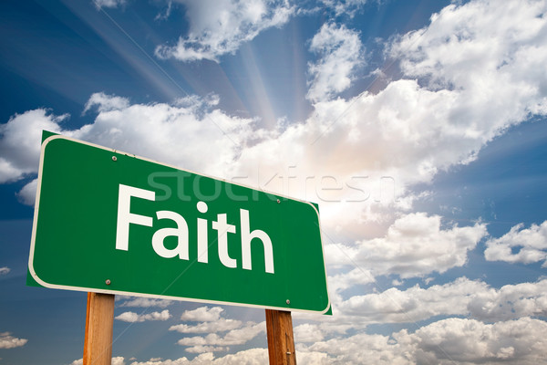 Faith Green Road Sign Over Clouds Stock photo © feverpitch