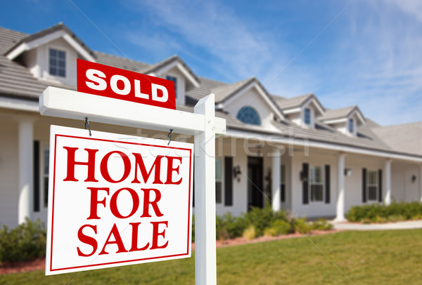 Sold Home For Sale Sign and New Home Stock photo © feverpitch