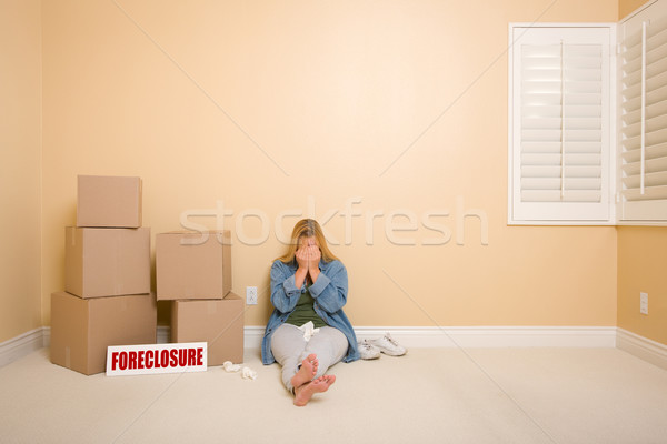 Stock photo: Upset Woman on Floor Next to Boxes and Foreclosure Sign