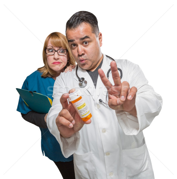 Goofy Doctor and Nurse with Prescription Bottle Isolated on a Wh Stock photo © feverpitch