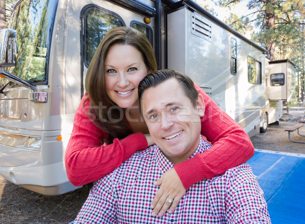 Happy Caucasian Couple In Front of Their Beautiful RV At The Cam Stock photo © feverpitch
