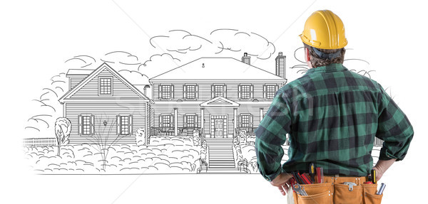 Male Contractor with Hard Hat and Tool Belt Looking At Custom Ho Stock photo © feverpitch