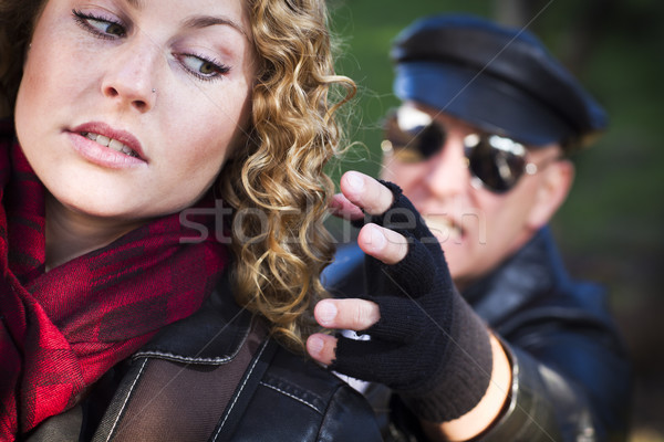 Pretty Young Teen Girl with Mysterious Man Reaching to Grab Her Stock photo © feverpitch