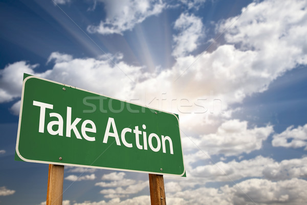 Take Action Green Road Sign and Clouds Stock photo © feverpitch