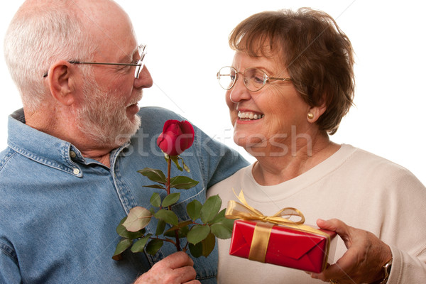 Stock photo: Happy Senior Couple with Gift and Red Rose