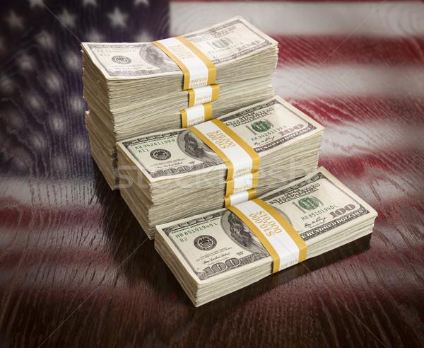 Zdjęcia stock: Dolarów · refleksji · amerykańską · flagę · tabeli · drewniany · stół