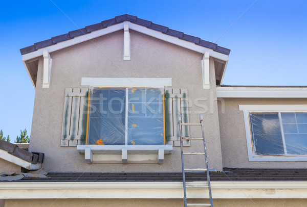 Ladder Leaning Up Against A House Ready For New Paint Stock photo © feverpitch