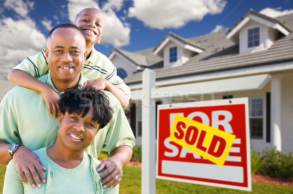 African American Family with Sold For Sale Sign and House Stock photo © feverpitch