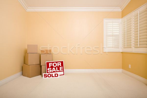 Boxes, Sale and Sold Real Estate Signs in Empty Room Stock photo © feverpitch