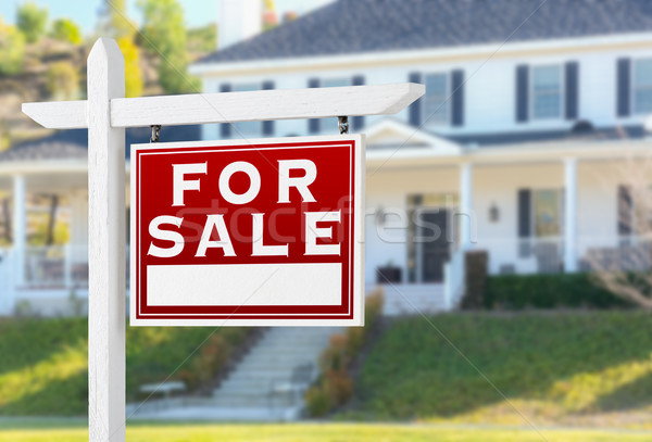 Right Facing For Sale Real Estate Sign In Front of House. Stock photo © feverpitch