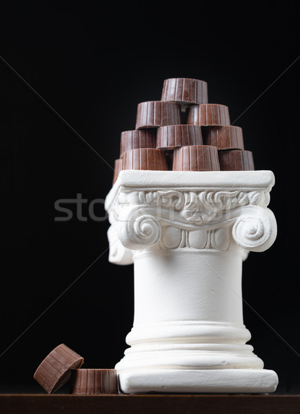 Stack of Fine Artisan Chocolates Stacked On White Pillar Column Stock photo © feverpitch