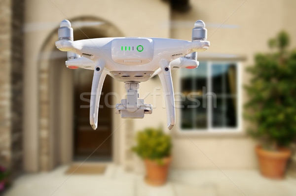 Back of Unmanned Aircraft System (UAV) Quadcopter Drone Flying I Stock photo © feverpitch