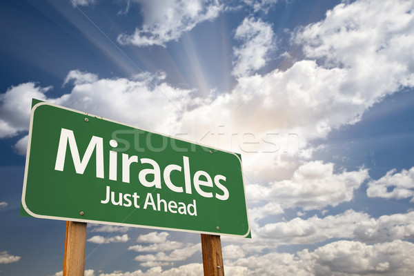 Stock photo: Miracles Green Road Sign Against Clouds
