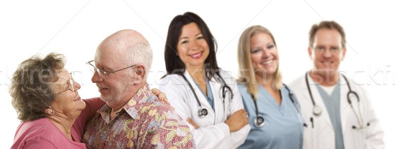 Casal de idosos médico médicos atrás feliz Foto stock © feverpitch